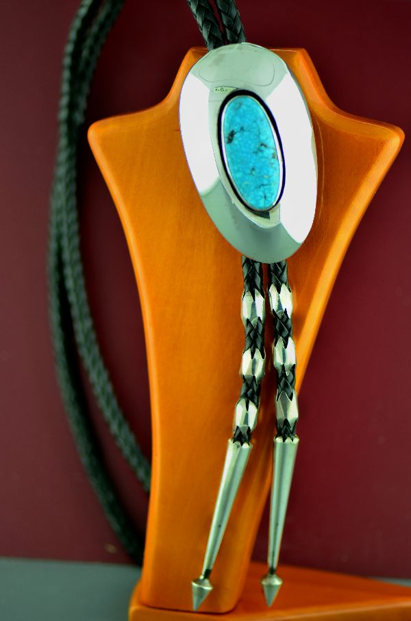 Navajo – Exquisite Sterling Silver Birds Eye Kingman Turquoise Bolo Tie with Sterling Silver Tips and Sleeves by Loren Begay  (Private Collection)