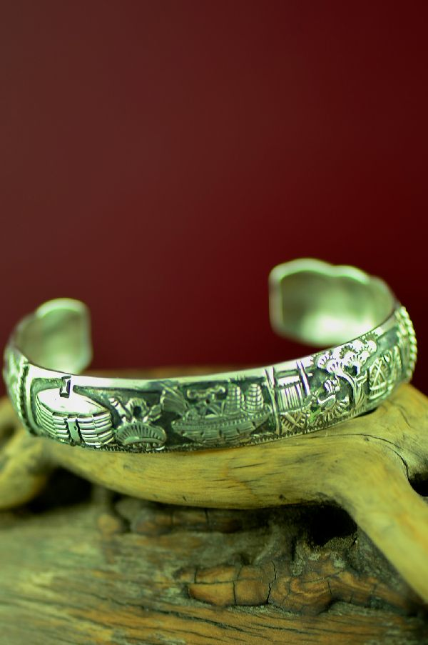 Navajo Sterling Silver Story Bracelet by Larry Etsitty