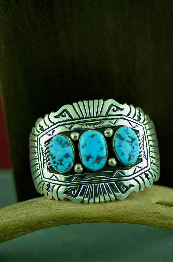 Navajo Exquisite Sterling Silver 3 Stone Sleeping Beauty Turquoise Bracelet with Water, Rain Drops, Rope, Arrow, Prayer Feathers and Sun symbols by the late Tommy Singer