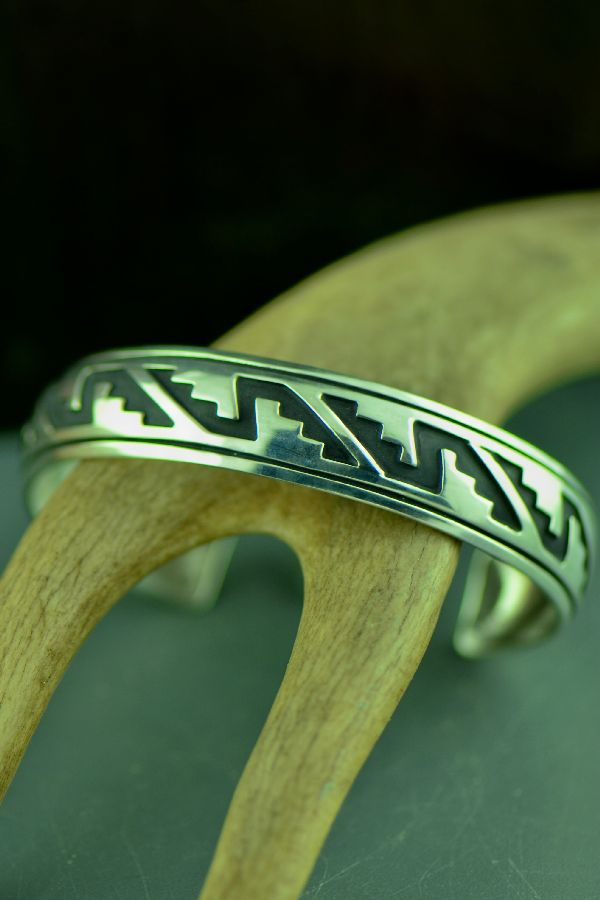 Navajo Sterling Silver Mountain, Wind and Sunburst Symbol Bracelet by the late Tommy Singer