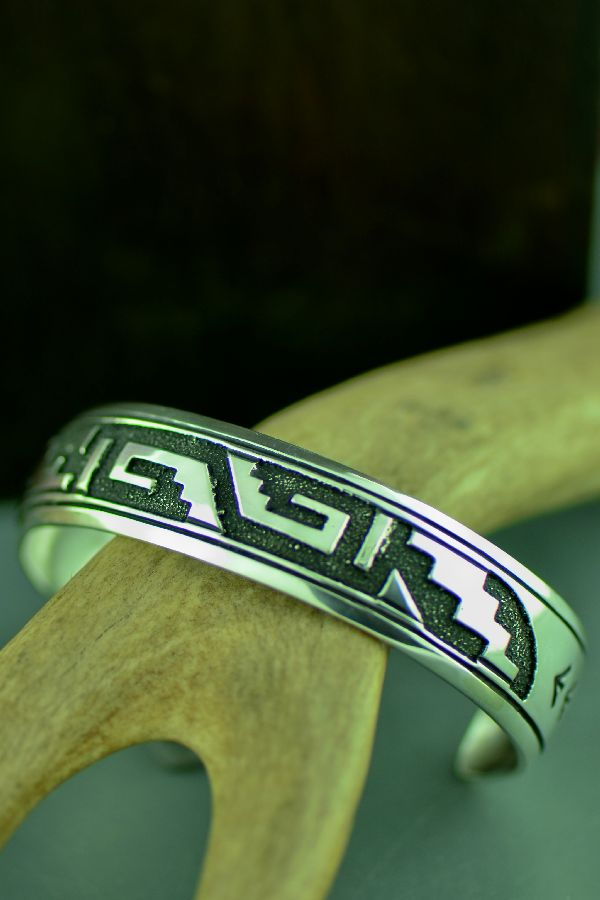 Navajo Sterling Silver Wind, Water, Mountain Symbol Bracelet by the late Tommy Singer