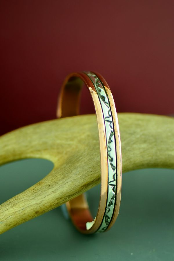 Navajo Sterling Silver and Copper Bracelet by Wylie Secatero