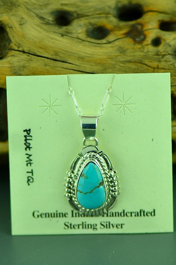 Navajo Sterling Silver Pilot Mountain Turquoise Pendant by Bennie Ration