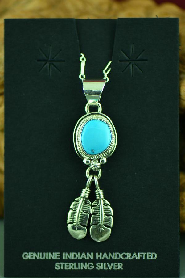 Native American Sleeping Beauty Turquoise Feather Pendant by Lucy Valencia
