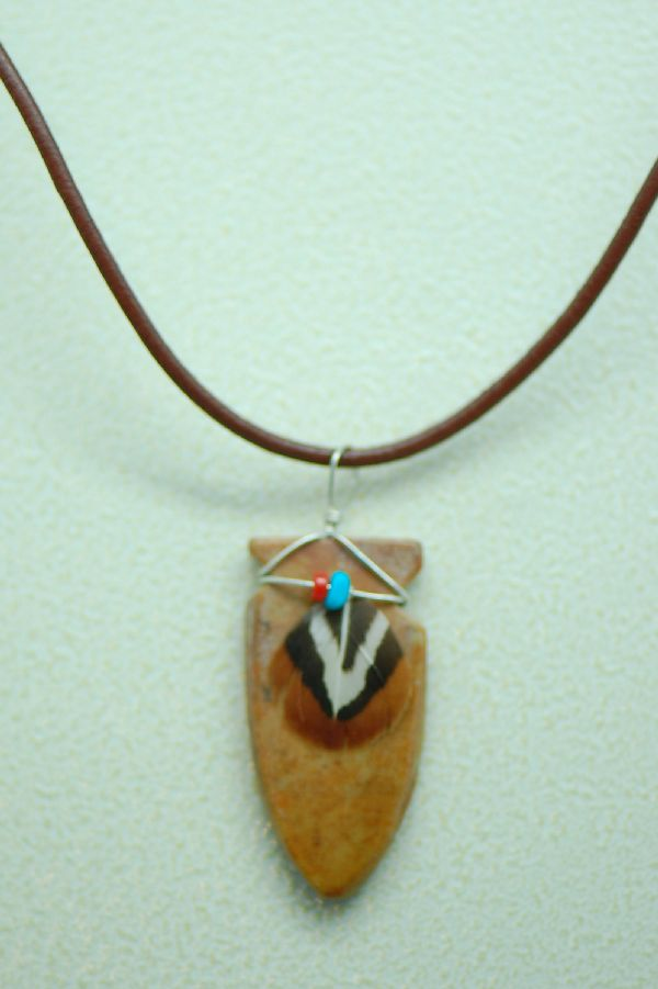 Navajo – Hand Carved Picasso Marble Arrowhead Pendant by DuWayne Turpen